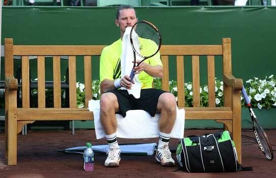 4/7/14:  Alex Bogomolov Jr. (RUS) rest between sets on day 1 at the U.S. Men's Clay Court Championship at River Oaks in Houston, TX. Querrey won 6-4,7-6. Photo: Thomas B. Shea / © 2014 Thomas B. Shea