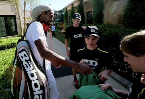 4/7/14: Dustin Brown (Ger) signs autographs on day 1 at the U.S. Men's Clay Court Championship at River Oaks Country Club in Houston, TX. Photo: Thomas B. Shea / © 2014 Thomas B. Shea