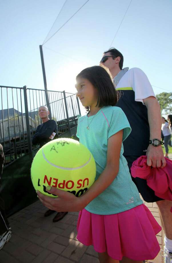4/7/14: Sophia Mazzucato , age 9 waits for an autograph on day 1 at the U.S. Men's Clay Court Championship at River Oaks Country Club in Houston, TX. Mazzucato has been coming to the tournament for two years. Photo: Thomas B. Shea / © 2014 Thomas B. Shea