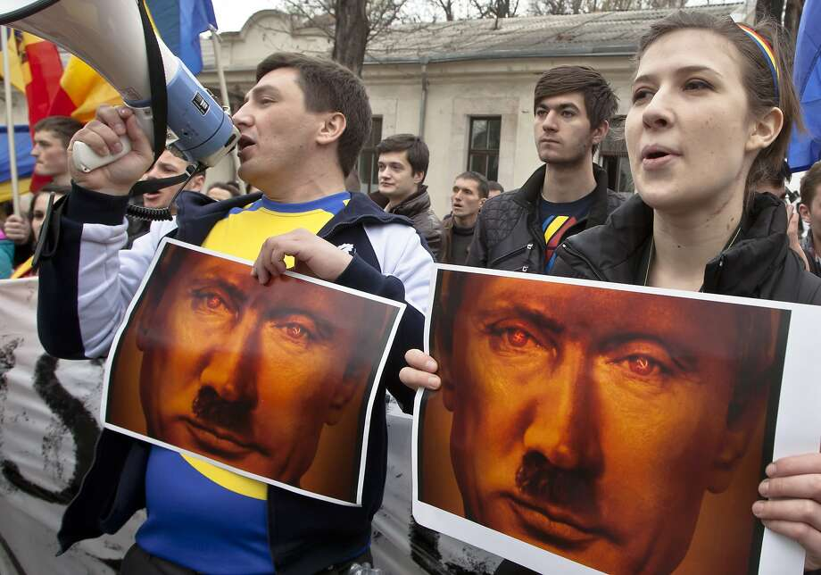 Look, unretouched photos of Putin! Young Moldovan protesters show off their Photoshop talents at a rally in Chisinau, Moldova. The demonstrators were condemning Russia's annexation of Crimea. Photo: Vitalie Plotnic, Associated Press
