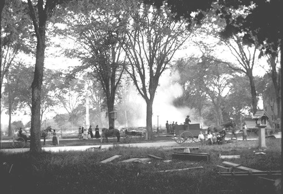 First Church Congregational was destroyed in a fire set by an arsonist the night before Memorial Day in 1890. Here onlookers survey the smoldering ruins. Courtesy: Fairfield Museum and History Center Photo: Contributed Photo / Fairfield Citizen