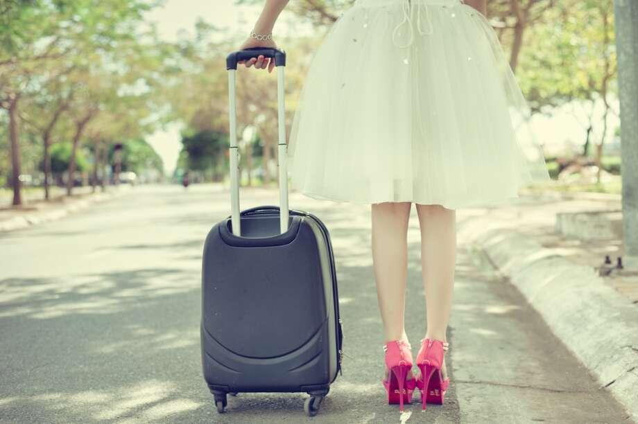 """""""Pack light. A carry on bag is enough.""""Being on your own means you're the only one who will have to lug around those heavy bags. Save yourself the trouble by bringing the bare minimum, just enough to cover your needs. Plus, leaving some room for trinkets you'll pick up during your travels is a must. Photo: Tuandang, Getty Images/Flickr RF"""