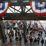 Fans go through security as they make their way into AT&T Park before the start of an opening day baseball game between the San Francisco Giants and the Arizona Diamondbacks in San Francisco, Tuesday, April 8, 2014. (AP Photo/Eric Risberg)