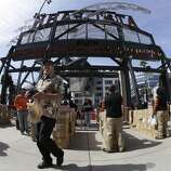 Fans enter AT&T Park before an opening day baseball game between the San Francisco Giants and the Arizona Diamondbacks in San Francisco, Tuesday, April 8, 2014. (AP Photo/Jeff Chiu)
