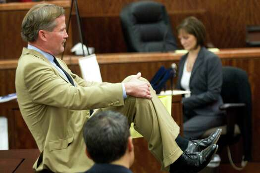 Defense attorney Jack Carroll gives his closing argument in the trail against Ana Lilia Trujillo Tuesday, April 8, 2014, in Houston. Trujillo, 45, is charged with murder, accused of killing her 59-year-old boyfriend, Alf Stefan Andersson with the heel of a stiletto shoe, at his Museum District high-rise condominium in June 2013. Photo: Brett Coomer, Houston Chronicle / © 2014 Houston Chronicle