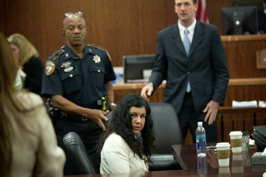 Ana Lilia Trujillo sits in the courtroom following closing arguments in her trial Tuesday, April 8, 2014, in Houston. Trujillo, 45, is charged with murder, accused of killing her 59-year-old boyfriend, Alf Stefan Andersson with the heel of a stiletto shoe, at his Museum District high-rise condominium in June 2013. Photo: Brett Coomer, Houston Chronicle / © 2014 Houston Chronicle