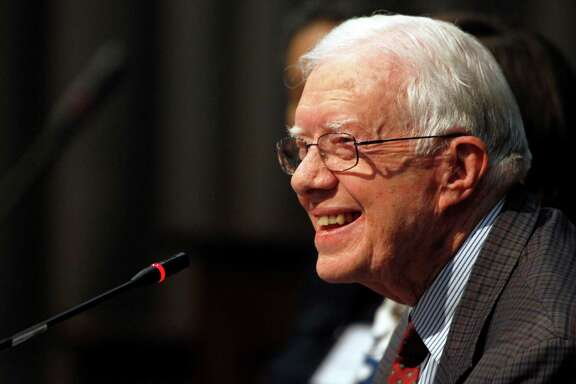 FILE - In this June 28, 2013 file photo, former U.S. President Jimmy Carter speaks in Atlanta. Carter will be the keynote speaker Tuesday, April 8, 2014 on the first day of the Civil Rights Summit at the LBJ Presidential Library in Austin, Texas. (AP Photo/Jaime Henry-White, File)