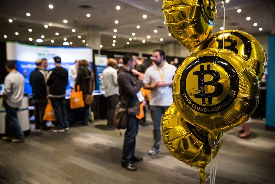 Bitcoin enthusiasts attend a conference about the virtual currency in New York on Monday. Photo: Andrew Burton, Getty Images
