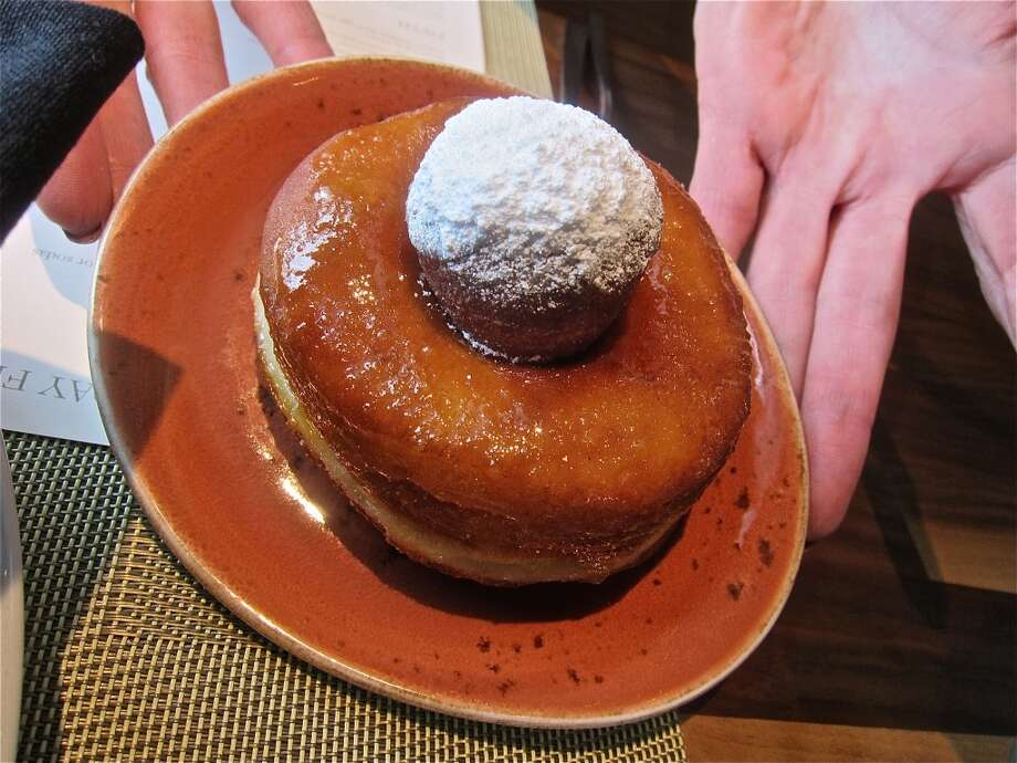 Passionfruit-glazed doughnut   by Samantha Mendoza, as served at Triniti's brunch. Photo: Alison Cook