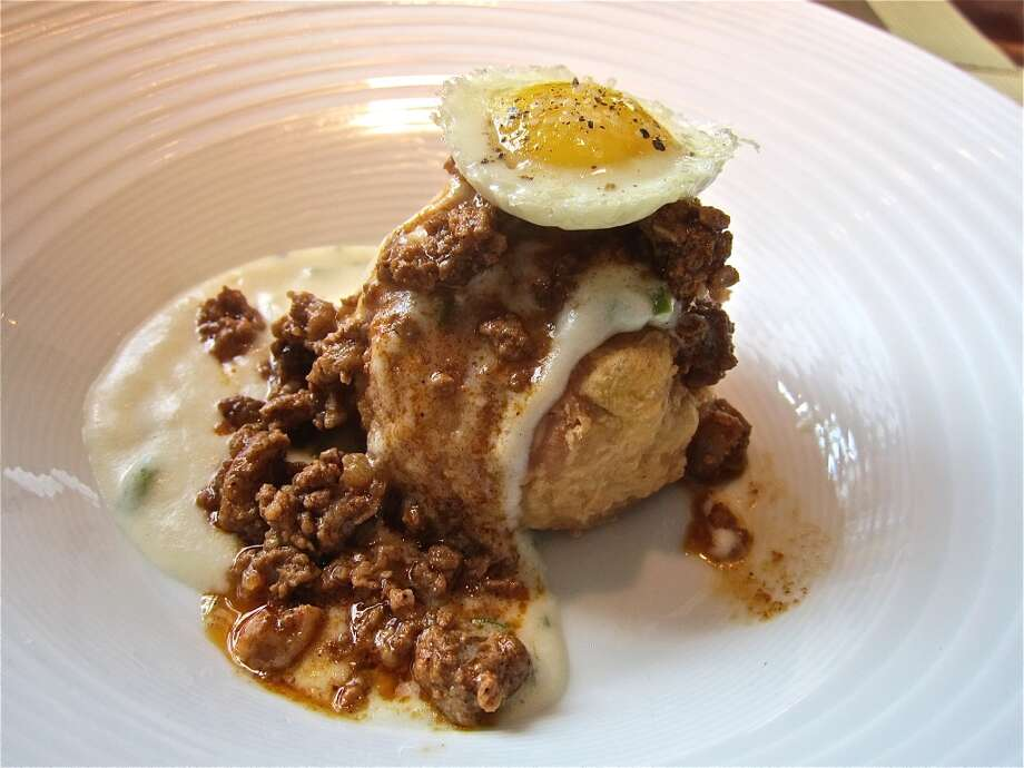 Chicken fried biscuit mini with a quail egg from Triniti's brunch menu. Photo: Alison Cook