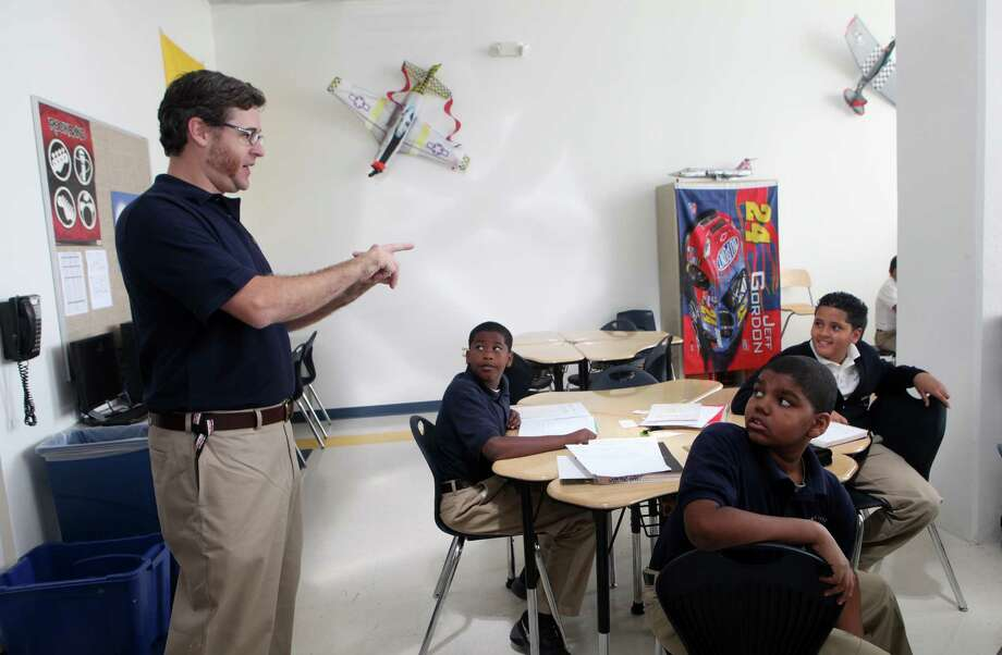Chris Van Etten teaches on the first day of school at Park City Prep on Monday, Sept. 9, 2013. The eight year old charter school moved to a new location on State St. in Bridgeport. Photo: BK Angeletti, B.K. Angeletti / Connecticut Post freelance B.K. Angeletti