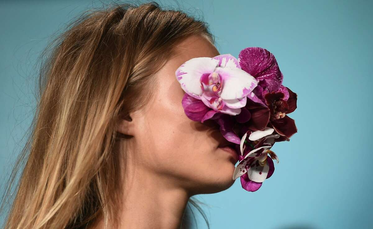 If you're going to Sydney, Australia,be sure to wear some flowers on your face: A model shows an accessory by Australian designer Toni Maticevski at Fashion Week Australia in Sydney.