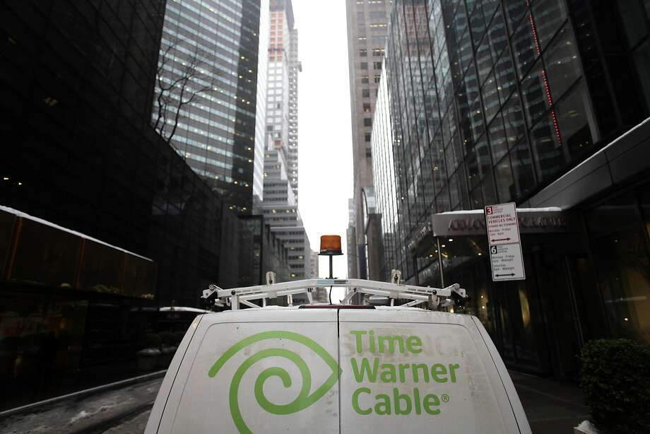 The Time Warner Cable logo is displayed on the back of a van in New York in this February 13, 2014, file photo. Comcast Corp's merger with Time Warner Cable Inc would not deprive consumers of TV or broadband choices and would help the two companies compete against newcomers including Google Inc and Apple Inc in the video market, Comcast told U.S. regulators on April 8, 2014. REUTERS/Joshua Lott/Files (UNITED STATES - Tags: BUSINESS SCIENCE TECHNOLOGY) Photo: Joshua Lott, Reuters