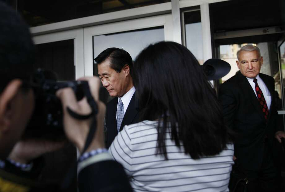 Suspended state Sen. Leland Yee (left) and attorney James Lassart (right) leave the federal building in S.F. Photo: Lea Suzuki, The Chronicle