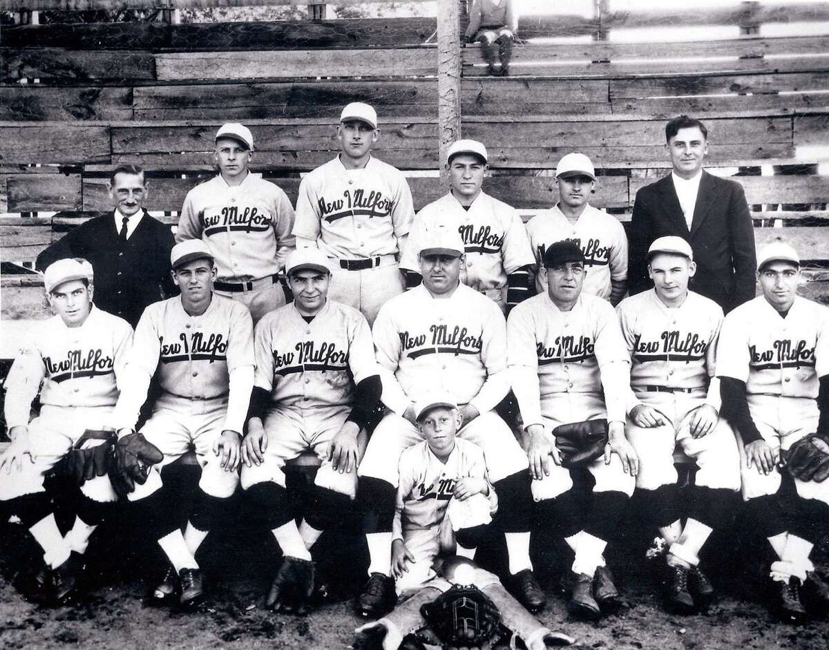 Flashback The Townies Courtesy of Stan Kwasniewski The rich history of our national pastime, baseball, in New Milford is chock full of tales of diamond derring-do by the local stars. For many years, a men's team called the Townies were a source of great pride to the community with their warm-weather exploits. The team comprised those just out of high school, including some exercising their talents in college ball, and those longer in the tooth but still capable as ballplayers. Among those seen here is Fred Collins, front row, second from the left, just recently graduated in this early 1930s photo from New Milford High School, where he'd led the team to several Housatonic Valley Schoolmen's League titles. Collins would go on to star at Providence College and was a top prospect in the New York Yankees' organization as a first baseman, charted to take over for Lou Gehrig, when injury shortened his career. Seen here on the bleachers at the old Young's Field diamond are bat boy Ed Wojciechowski; front row, from left to right, Denny Faure, Fred Collins, Paul Travaglini, Frank (Swivel) Adams, Bill Marshall, Ken Law and Paul (Baldy) Cartellli; back row, Art Smalley, Ray Hagstrom, Pat Peet, Ben Travaglini, Ray Lumley and Tony Kwasniewski. Those who would like to loan or contribute a photo from any of the Greater New Milford-area towns should bring it to Norm Cummings at the Greater New Milford Spectrum office at 45B Main St. or email ncummings@newstimes.com. If the photo is to be returned, please leave a phone number and mailing address.