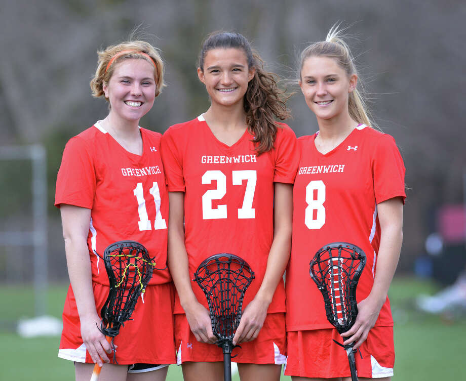 Greenwich High School girls lacrosse captains from left, Nicole Graham (#11), Carolyn Paletta (#27) and Emily Ludington (#8), at the school in Greenwich, Tuesday, April 8, 2014. Photo: Bob Luckey / Greenwich Time
