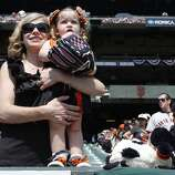 Janie and Emily, 3 of San Jose, are all set in their Giants' attire as the San Francisco Giants prepare to take on the Arizona Diamondback during their home opener at AT&T Park on Tuesday April 8, 2014, in San Francisco, Calif.