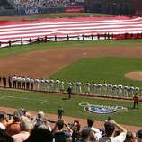 The National Anthem is sung during the opening ceremonies as the San Francisco Giants prepare to take on the Arizona Diamondback during their home opener at AT&T Park on Tuesday April 8, 2014, in San Francisco, Calif.