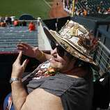 Sandy Wooten, who shivered through countless games as a season-ticket holder at Candlestick Park in the 1980s and '90s, enjoys the extraordinarily warm Opening Day at AT&T Park.