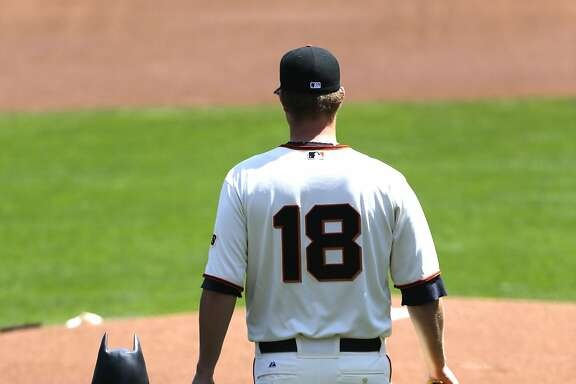 """Giants' pitcher Matt Cain leads """"Bat kid"""" out to the mound to throw the first pitch during opening ceremonies as the San Francisco Giants prepare to take on the Arizona Diamondback during their home opener at AT&T Park on Tuesday April 8, 2014, in San Francisco, Calif."""