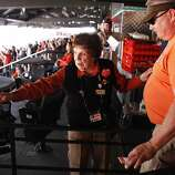 Usher Mary Maglio, 92, helps a fan find his seat on opening day at AT&T Park on April 8, 2014 in San Francisco, Calif. In their home opener, a day game, the San Francisco Giants face the Arizona Diamondbacks.