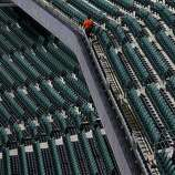 Giants employees clean seats on opening day at AT&T Park on April 8, 2014 in San Francisco, Calif. In their opening day game, the San Francisco Giants face the Arizona Diamondbacks.