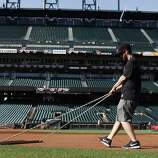 Jeff Winsor, manager of field operations, drags the infield skin on opening day at AT&T Park on April 8, 2014 in San Francisco, Calif. In their opening day game, the San Francisco Giants face the Arizona Diamondbacks.