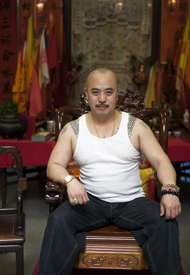 "Raymond ""Shrimp Boy"" Chow, is seen posing for a portrait in San Francisco in July 2007.  Investigators say Chow is the leader of one of the most powerful Asian gangs in North America. Chow's gang is said to have lured state Sen. Leland Yee into its clutches through money and campaign contributions in exchange for legislative help, as Yee sought to build his campaign coffers to run for California Secretary of State. Yee and Chow were both arraigned on federal gun and corruption charges on Wednesday, March 26, 2014. Photo: Jen Siska, Associated Press"