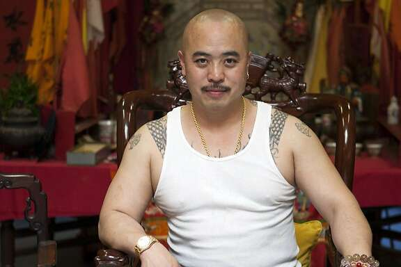 "In this image provided by Jen Siska, Raymond ""Shrimp Boy"" Chow, is seen posing for a portrait in San Francisco in July 2007.  Investigators say Chow is the leader of one of the most powerful Asian gangs in North America. Chow's gang is said to have lured state Sen. Leland Yee into its clutches through money and campaign contributions in exchange for legislative help, as Yee sought to build his campaign coffers to run for California secretary of state. Yee and Chow were both arraigned on federal gun and corruption charges on Wednesday, March 26, 2014. (AP Photo/Jen Siska) MAGS OUT NO SALES NO ARCHIVE"