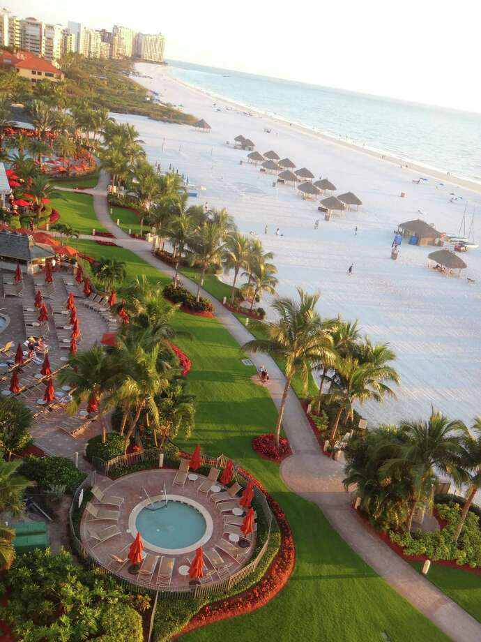 A view of manicured beachside grounds and walkways from a Marco Island Marriott resort tower. Photo: Robin Soslow, For The Express-News