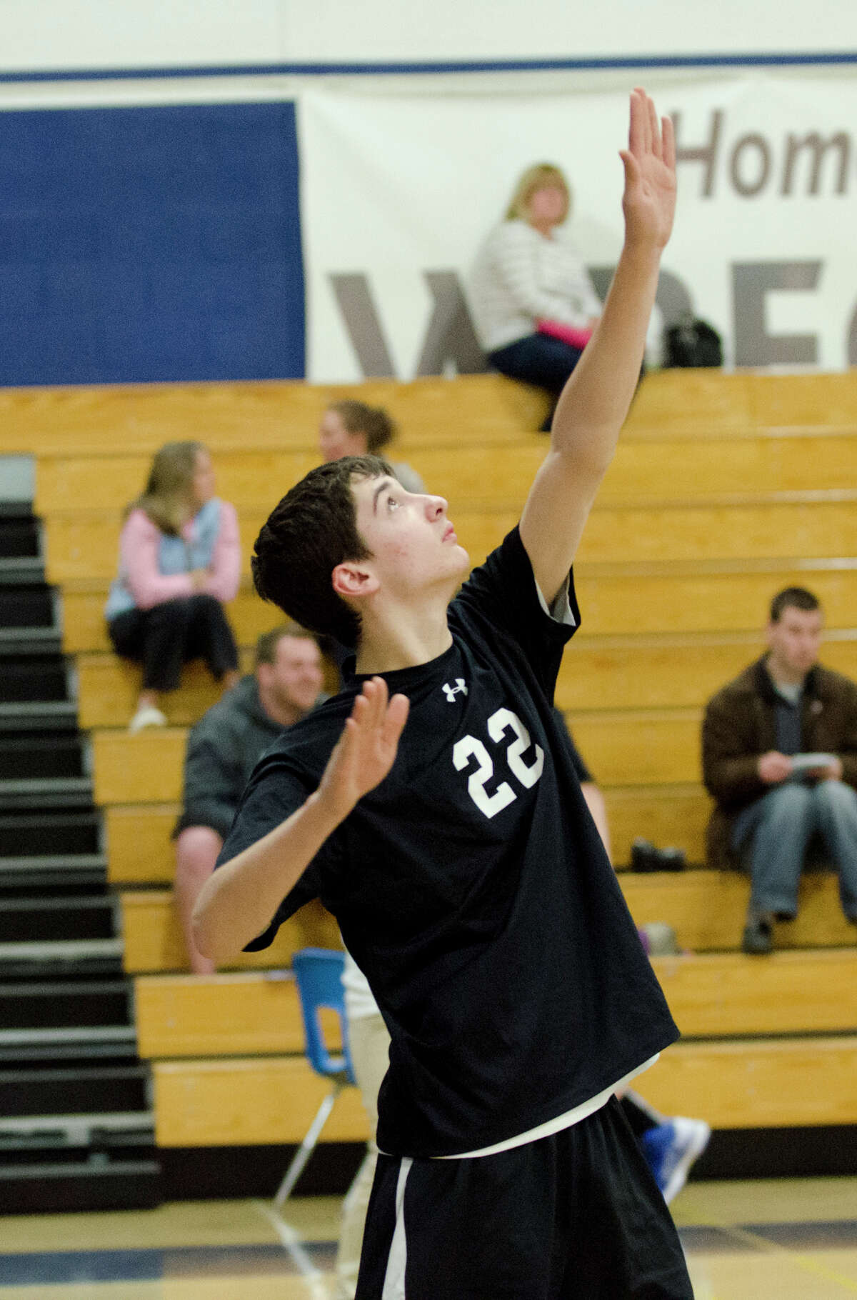 Fairfield Ludlowe/Warde co-op's Tim Beradino (22) serves the ball during the boys volleyball game against Staples at Staples High School in Westport on Monday, Apr. 15, 2013.