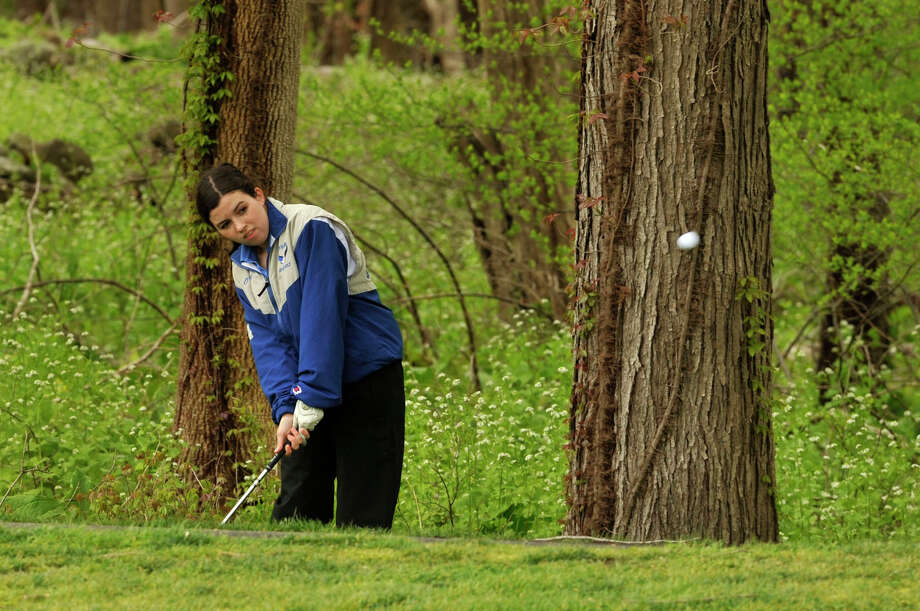 Fairfield Ludlowe's Kate O'Neill chips the ball out of the rough during their match against Danbury at Richter Park Golf Course in Danbury, Conn., on Tuesday, May 1, 2012. Danbury won 205-224. Photo: Jason Rearick / The News-Times