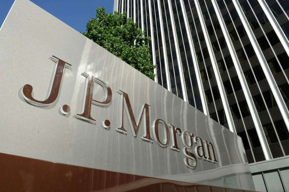 (FILES)A JPMorgan sign is seen outside the office tower housing the financial services firm's Los Angeles, California offices, in this August 8, 2013 file photo.  US banking giant JPMorgan Chase announced March 19, 2014 it is selling its physical commodities business to Swiss trading firm Mercuria Energy Group Limited for $3.5 billion. The deal divests physical commodities assets, transactions and energy and metals trading staff to Mercuria, which was founded in 2004  by two former Swiss traders at Goldman Sachs and is well known in energy and commodity trading circles.  AFP PHOTO / Robyn BeckROBYN BECK/AFP/Getty Images Photo: ROBYN BECK / AFP ImageForum