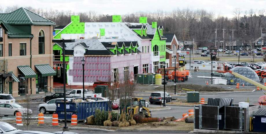 Rear of the Village at New Loudon showing finished buildings and current construction Tuesday, April 8, 2014, on Route 9 near Hoffman's Playland in Colonie, N.Y. The property is currently home to Bellini's restaurant, Dunkin' donuts, Rumors Spa, Berkshire Bank and Tala Bistro from Mazzone Hospitality. (Will Waldron/Times Union) Photo: WW / 00026412A