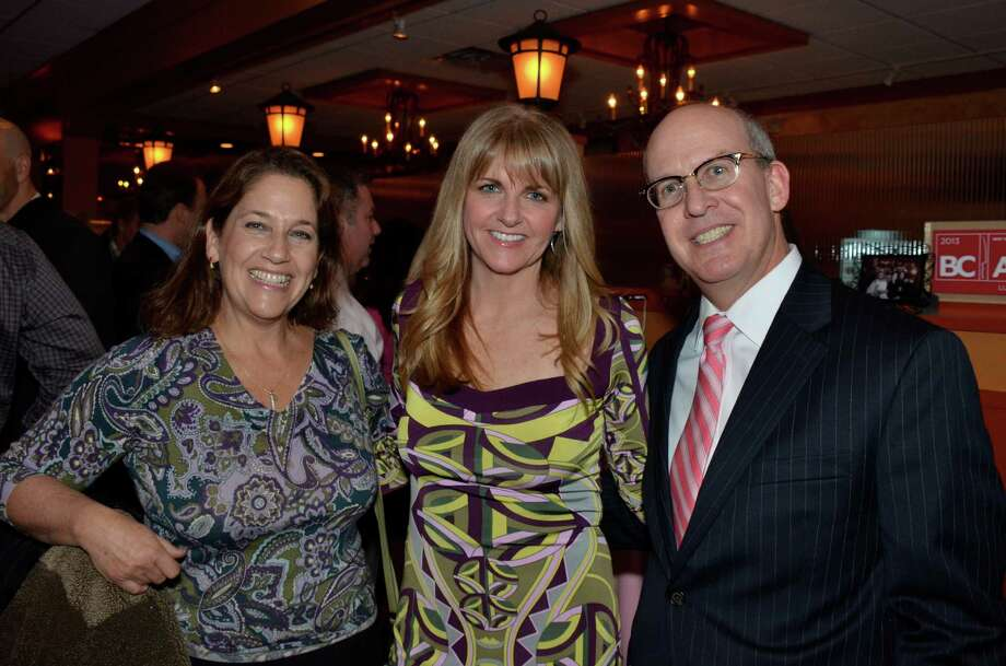 Dr. Stephanie Goldpin, OBGYN; Beth Allen Reilly, breast cancer survivor and party host; and Dr. David Gruen, Director of Women's Imaging, Stamford Health Integrated Practices.  The three stand together at Beth's pink-themed cocktail party, in appreciation for everyone who cares about those who have overcome, fought or are fighting breast cancer.  Hosted by Chef Luis in New Canaan, Conn., on March 28, 2014. Photo: Jeanna Petersen Shepard, Freelance Photo / New Canaan News freelance