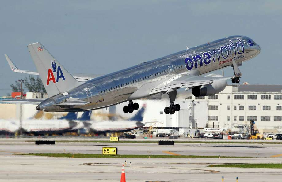 In this Thursday, Oct. 11, 2012 photo, an American Airlines Boeing 757 passenger jet takes off from Miami International Airport in Miami. (AP Photo/Wilfredo Lee) ORG XMIT: NYBZ149 Photo: Wilfredo Lee / AP