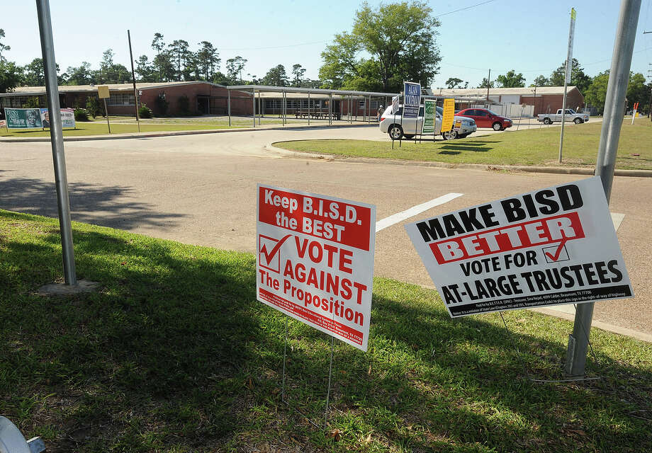 Voting signs for BISD's biggest opposing groups BETTER and BEST stand in the ground outside Austin Middle School on Saturday. The groups' biggest controversy included a proposition to alter the board's seating passed by more than 1,000 votes. Guiseppe Barranco/The Enterprise