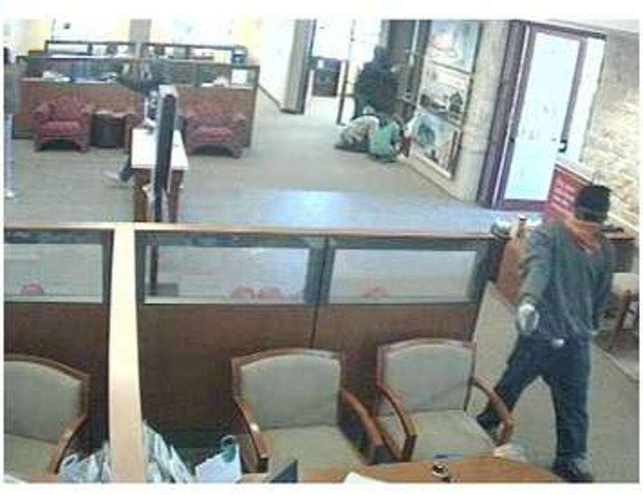 A surveillance image of the robbery at a Wells Fargo bank at Texas 99 near Bay Hills on Tuesday. Photo: Fort Bend County Sheriff's Office