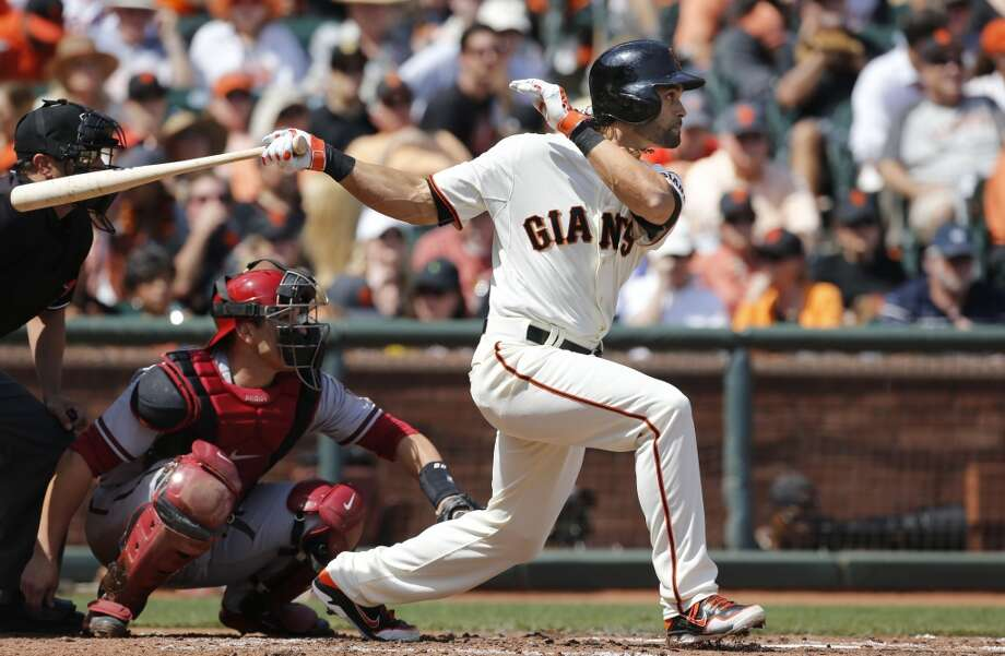 Giants Angel Pagan, (16) watches his third inning double, as the San Francisco Giants take on the Arizona Diamondback during their home opener at AT&T Park on Tuesday April 8, 2014, in San Francisco, Calif. Photo: Michael Macor, The Chronicle
