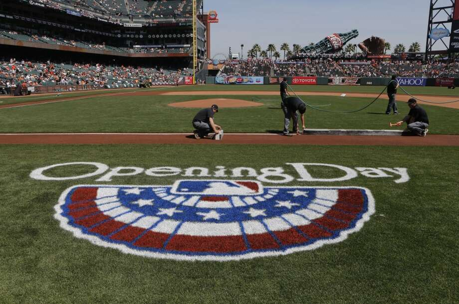 A ground crew gets set for the opening ceremonies as the San Francisco Giants prepare to take on the Arizona Diamondback during their home opener at AT&T Park on Tuesday April 8, 2014, in San Francisco, Calif. Photo: Michael Macor, The Chronicle