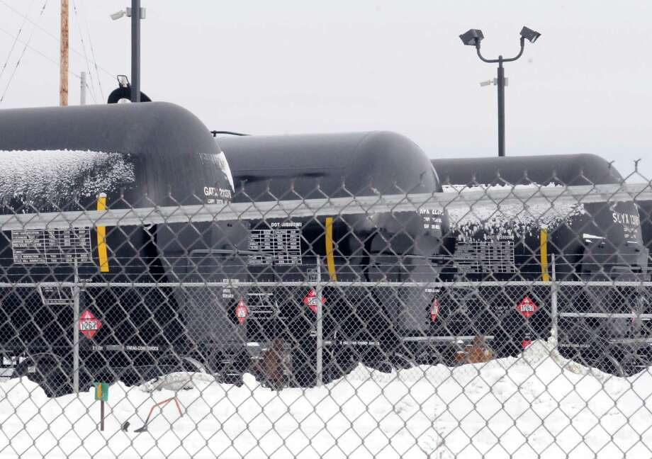 Rail tanker cars in the Port of Albany on Tuesday Feb. 18, 2014 in Albany, N.Y. Starting in April Irving Oil will only ship crude in the latest DOT-111 cars (CPS-1232), those that meet the newest crash standards. Also, Marketplace last night reported that both CP and CN will charge shippers more for oil in the less-safe, older DOT-111 cars. Obviously, I'll want to see how all of this affects the rail cars coming into the Port of Albany. (Michael P. Farrell/Times Union) Photo: Michael P. Farrell / 00025813A