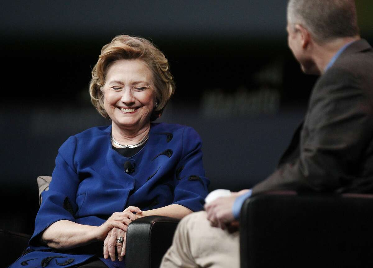 Former Secretary of State Hillary Clinton, left, laughs with Marketo CEO Phil Fernandez as he makes reference to her rumored possible campaign for President during a Q&A following her keynote speech for Marketo at the Marketing Nation Summit April 8, 2014 at Moscone Center West in San Francisco, Calif. The speech was one of a few speaking appearances Clinton will be making on the West Coast in the next few days.