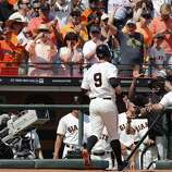 Giants Brandon Belt, (9) with a first inning home run to score Angel Pagan, (16) as the San Francisco Giants take on the Arizona Diamondback during their home opener at AT&T Park on Tuesday April 8, 2014, in San Francisco, Calif.
