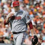 Diamondbacks starting pitcher Trevor Cahill, (35) gets out of the third inning with the San Francisco Giants leading the Arizona Diamondback 5-1 during Giants home opener at AT&T Park on Tuesday April 8, 2014, in San Francisco, Calif.