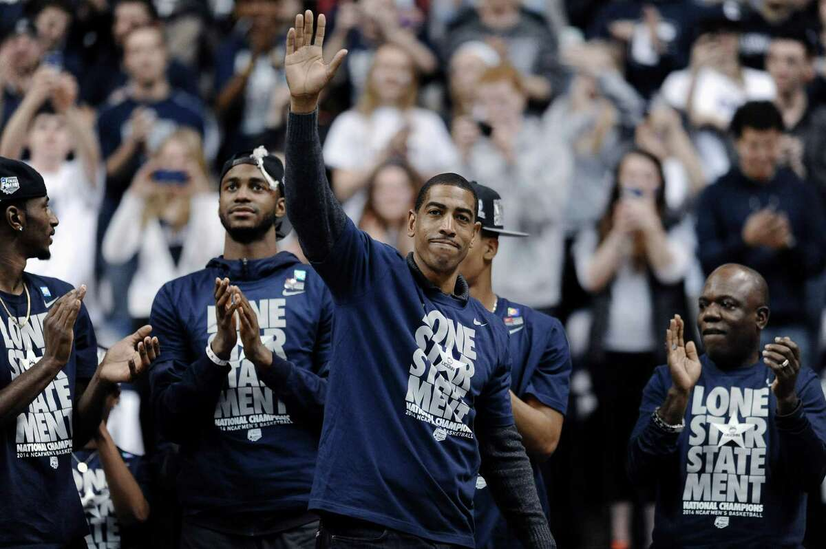 Connecticut coach Kevin Ollie waves to fans at a pep rally Tuesday, April 8, 2014, in Storrs, Conn., the day after the team won the NCAA men's Division I basketball championship.