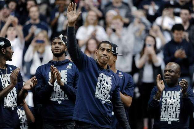Connecticut coach Kevin Ollie waves to fans at a pep rally Tuesday, April 8, 2014, in Storrs, Conn., the day after the team won the NCAA men's Division I basketball championship. Photo: Jessica Hill, AP / FR125654 AP