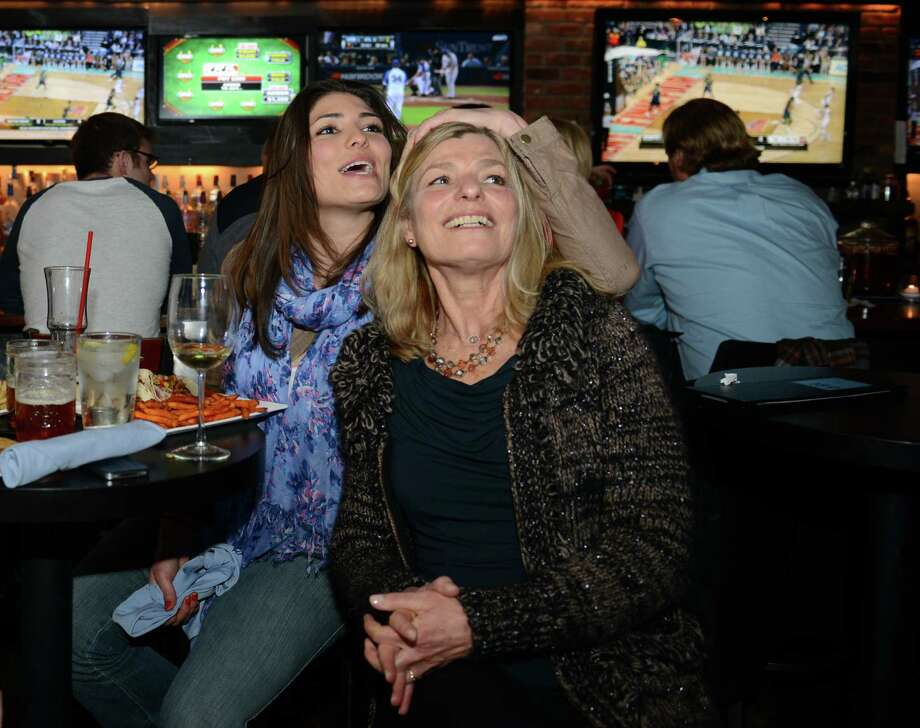 Karla Alstranner, left, and Amber Rose Hardie, of Brookfield, hang out at 189 Sports Cafe in Brookfield, Conn. to watch the University of Connecticut women's basketball team play Notre Dame in the NCAA women's college basketball national championship game in Nashville, Tenn. on Tuesday, April 8, 2014. Photo: Tyler Sizemore / The News-Times