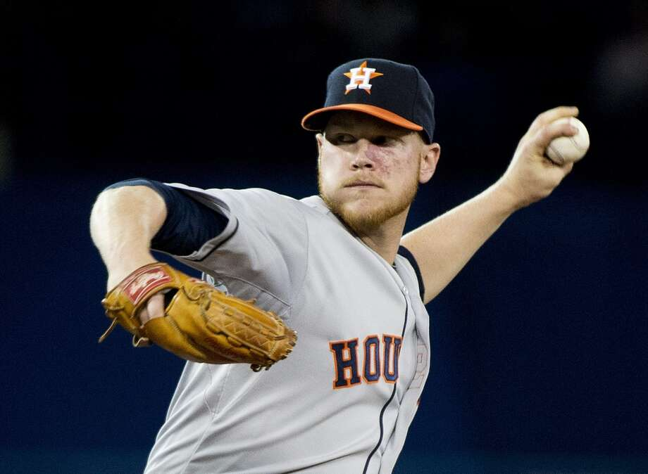 Brett Oberholtzer of the Astros delivers a pitch to the Blue Jays. Photo: Nathan Denette, Associated Press/The Canadian Press