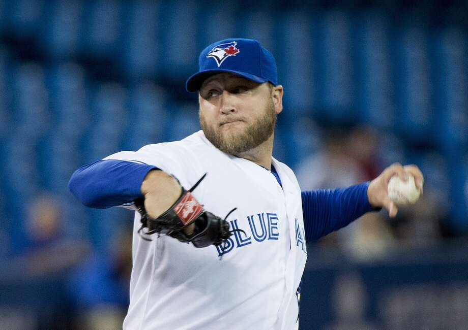 Blue Jays pitcher Mark Buehrle delivers a throw to the Astros. Photo: Nathan Denette, Associated Press/The Canadian Press