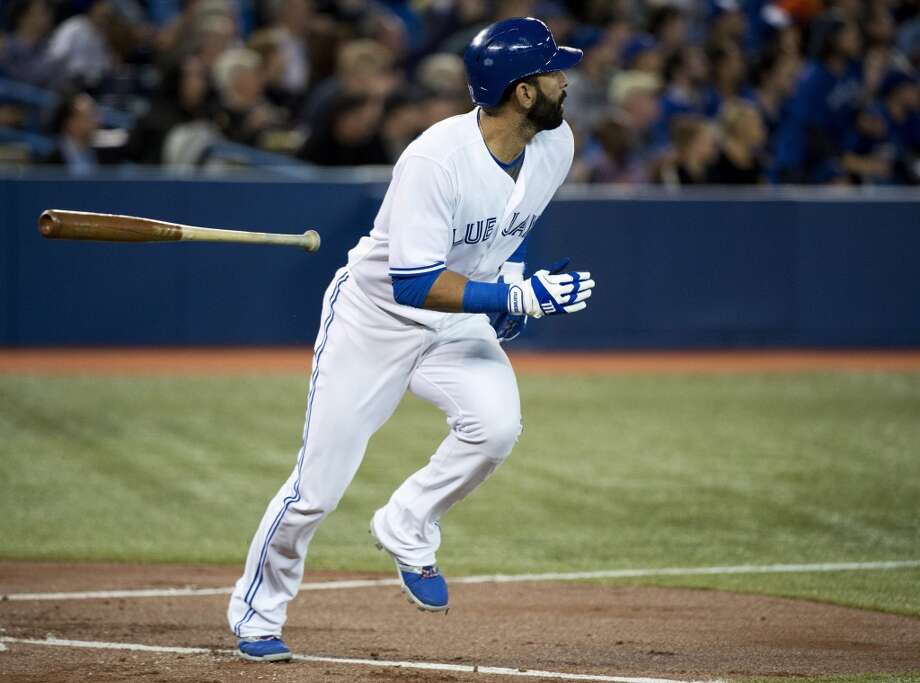 Jose Bautista of the Blue Jays watches his home run sail over the fence against the Astros. Photo: Nathan Denette, Associated Press/The Canadian Press